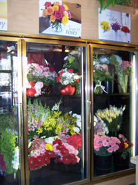 Refrigerated display coolers for cut flowers and delicate products